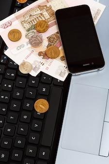 Russian rubles over laptop keyboard