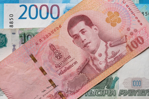Russian rubles and thai baht close-up.