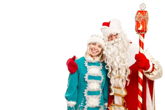 Russian santa claus with a snow maiden hug and smile. festive mood. isolated over white background. space for text.