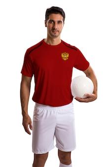 白いスペースにボールを保持しているロシアのサッカー選手
