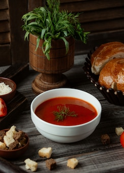 Russian soup borsh with herbs and crackers