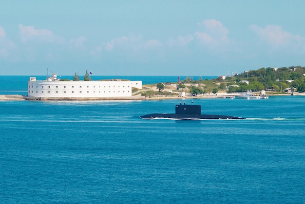 Russian submarine go out from the bay.