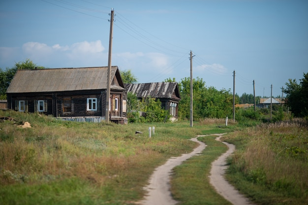 Russian village, beautiful countryside with houses and road