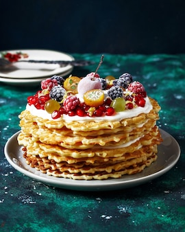 Russian waffle cake with sour cream and berries