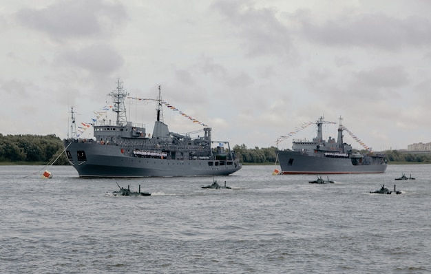 Russian warships in volga river in astrakhan in summer at cloudy day. russian military vessels.