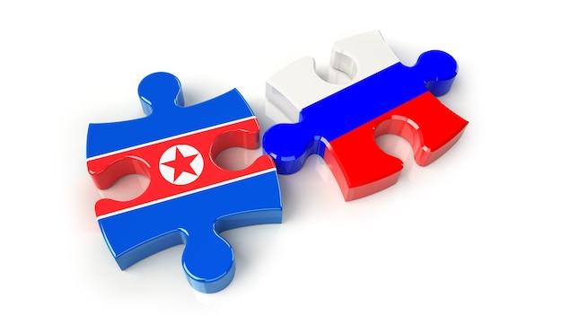 퍼즐 조각에 러시아와 북한 플래그입니다. 정치적인 관계 개념입니다. 3d 렌더링
