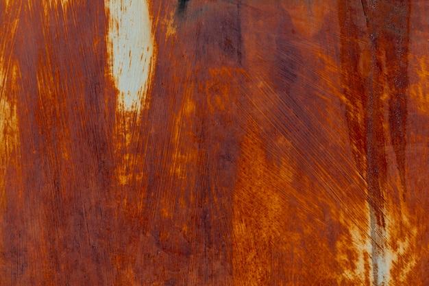 Rust on aged metallic surface