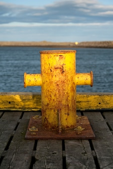 Rusted dock cleat in the reykjanes peninsula in iceland