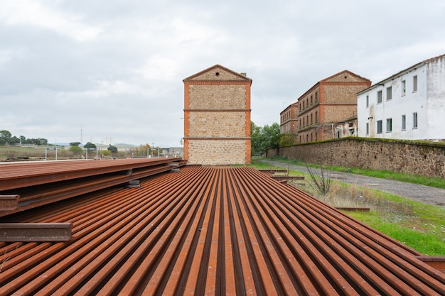 Rusted iron train rails and beams at the monfrague palazuelo empalme train station in malpartida de plasencia