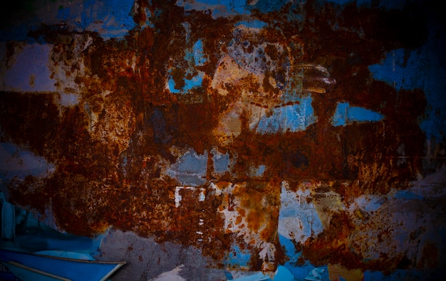 Rusted metal plate with saturate red and blue at the wall of food store