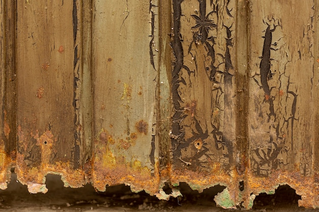 Rusted metal surface with paint chipping