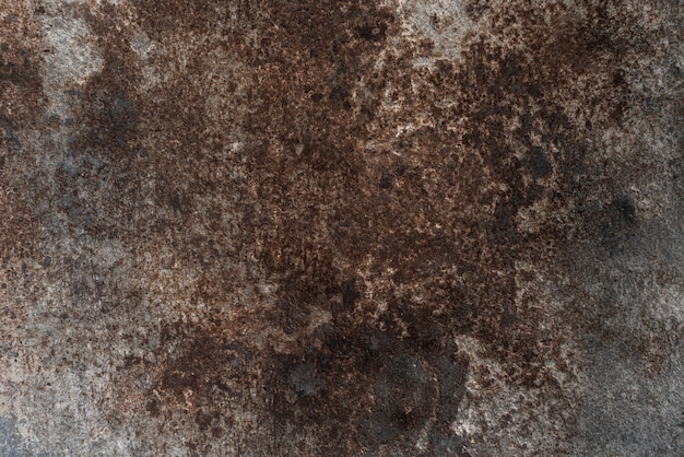 Rusted on surface of the old iron, deterioration of the steel, decay and grunge rough. dark patina copper metal background texture. vintage effect. ã¢â€â‹texture background