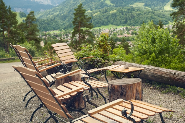 Rustic armchair and peaceful mountain view