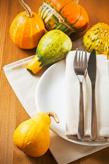 Rustic autumn table setting on wooden table