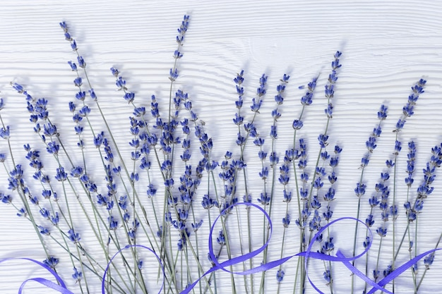 Rustic background with lavender flowers on white wooden surface. selective focus.