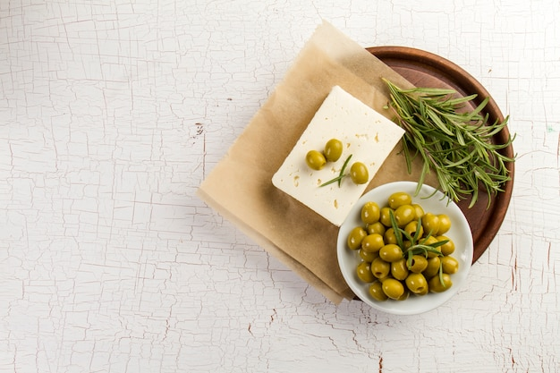 Rustic background with olives and aromatic herb