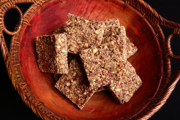 Rustic bowl of peanut brittle dessert
