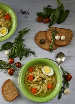 Rustic chicken soup with noodles and vegetables