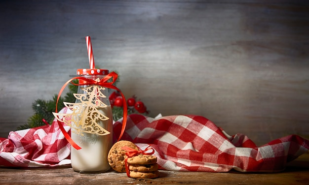 Rustic christmas background with milk and cookies