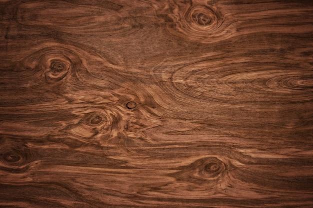 素朴なダークウッドの床板のテクスチャ背景