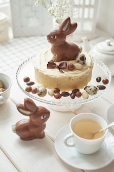 Rustic easter cake with chocolate bunnies and eggs.