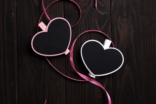 Rustic hanging menu blackboard decorated wooden hearts on wooden background