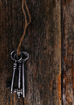 Rustic keys on wooden table
