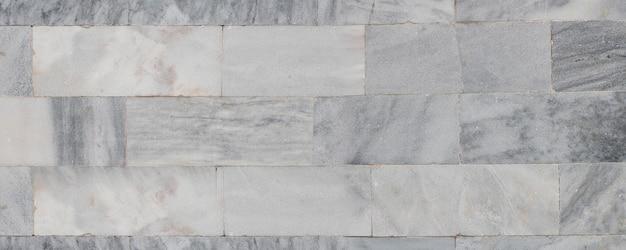Деревенская мраморная стена и серый каменный фон текстуры Premium Фотографии