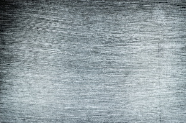 素朴な金属の背景、洗練されたパターンと軽金属の質感
