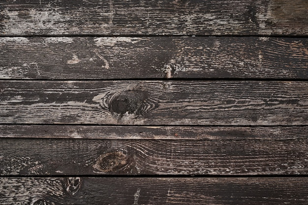 Rustic old dark wooden background with pine wood, structure of wood with knots