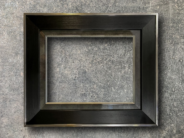 Rustic picture frame on cement wall
