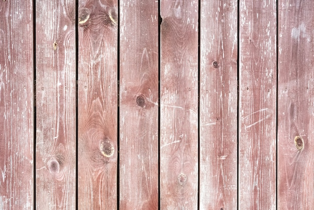 Rustic plank fence brown old bark wood textured photo.