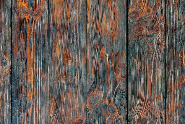 Деревенский регенерированный фон текстуры древесины. старинный деревянный стол. красно-черная поверхность старого сучковатого дерева