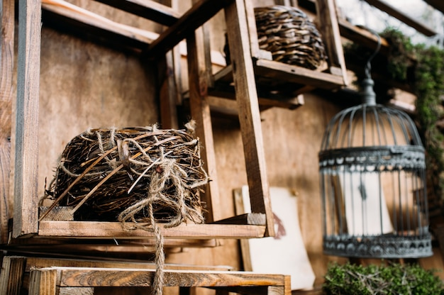 Rustic stylish wall composition with basket and bird cage