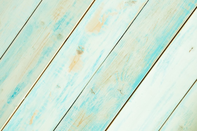 Rustic turquoise blue wooden planks diagonally