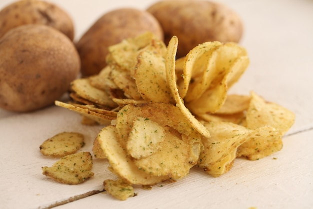 Rustic unpeeled potatoes and chips