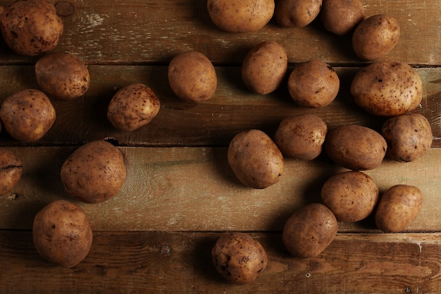 Rustic unpeeled potatoes on a desks