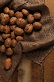 Rustic unpeeled potatoes on a desks