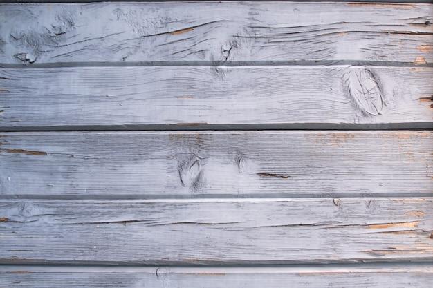 素朴な風化した青と白のグランジ素朴な木製パネル。木製の老化したテクスチャ板ストックフォト