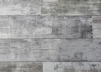 素朴な風化した木の表面に並ぶ長い板