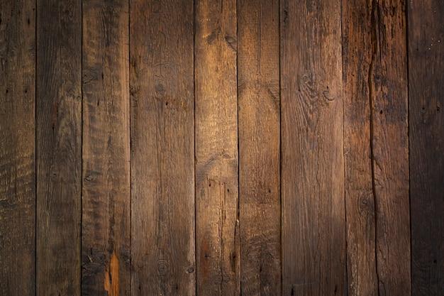 素朴な風化した木製の背景。センターライトエリア。テクスチャード加工の背景。