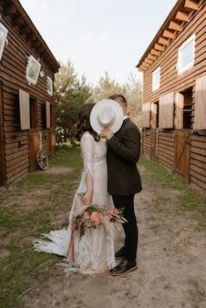 Rustic wedding couple on the horse farm