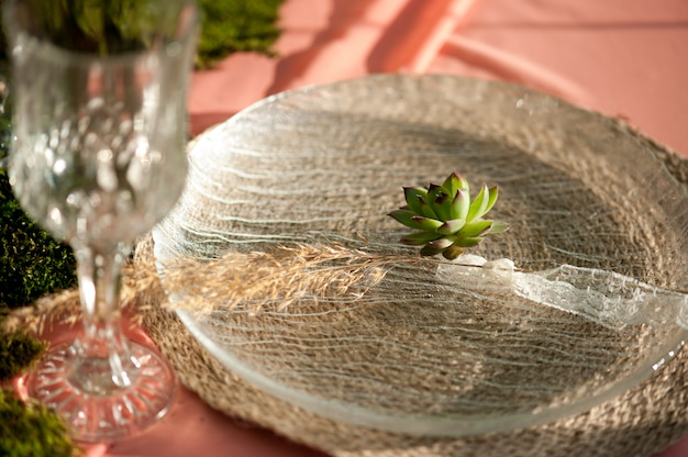 Rustic wedding table setting with succulents and moss
