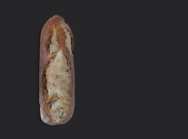 Rustic wheat bread on black