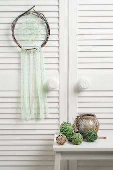 Rustic wicker dream catcher with green threads