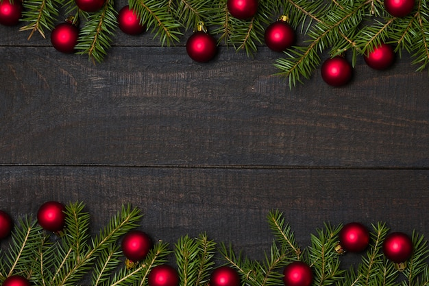 Rustic wood background, christmas decoration red ornament frame.