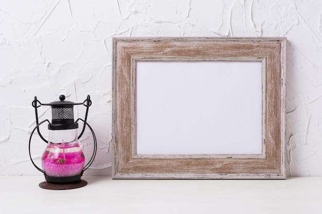 Rustic wooden landscape frame mockup with metal candle lantern.