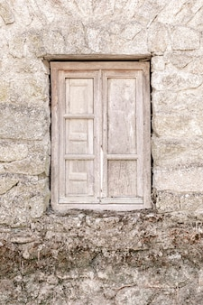 Rustic wooden window in old stone house