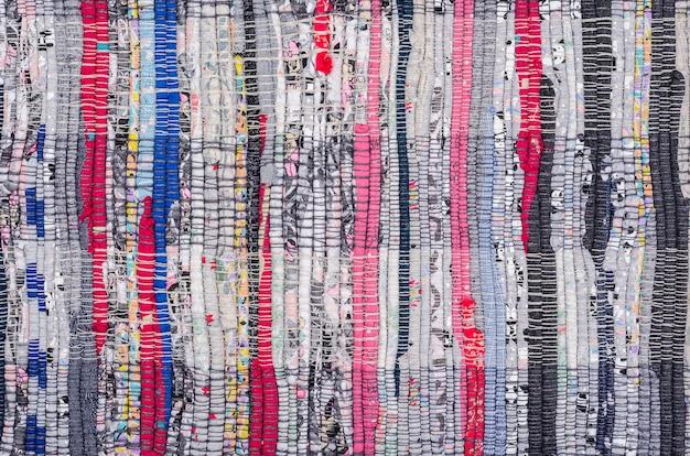 Rustikラグフロアマット。繊維廃棄物のリサイクル無駄のない生産