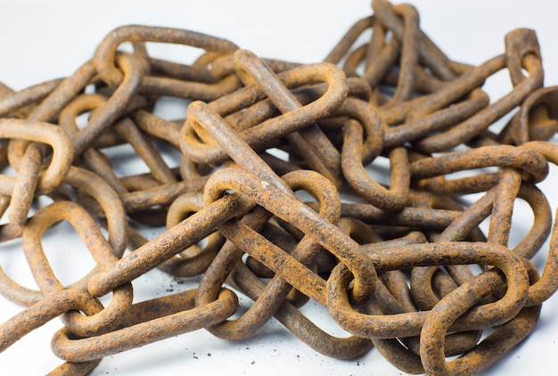 Rusty chains on white background. close up photo.